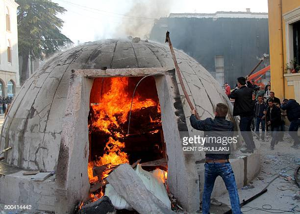 TOPSHOT Opposition protesters destroy a bunker installed as an artwork near the Interior ministry during a rally organized by the opposition...