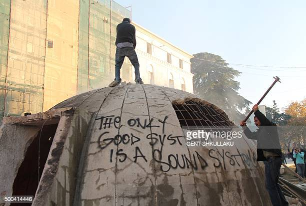Opposition protesters destroy a bunker installed as an artwork near the Interior ministry during a rally organized by the opposition Democratic Party...