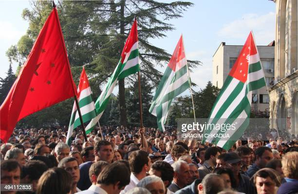 Opposition protesters rally in front of the presidential office in Sukhumi the capital of the Georgia's breakaway republic of Abkhazia on May 27 2014...