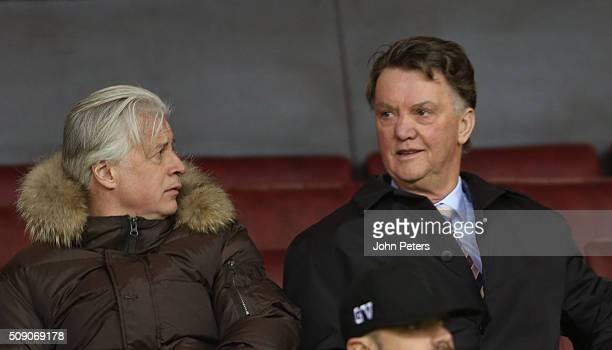 Opposition scout Marcel Bout and Manager Louis van Gaal of Manchester United watch from the stand during the U21 Premier League match between...