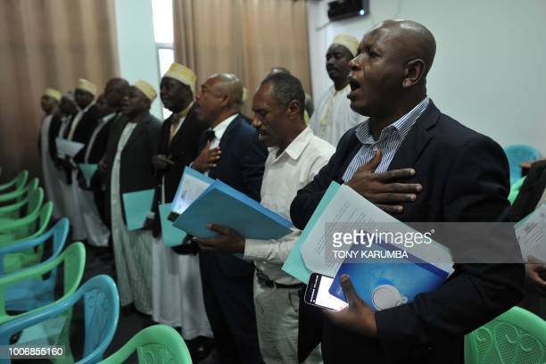 Opposition sing in unison an anthem to show their solidarity with proposals to stop a referendum read out among themselves at a press conference July...