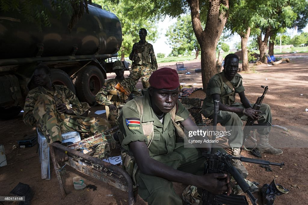 Opposition soldiers fighting under General Peter Gadet rest