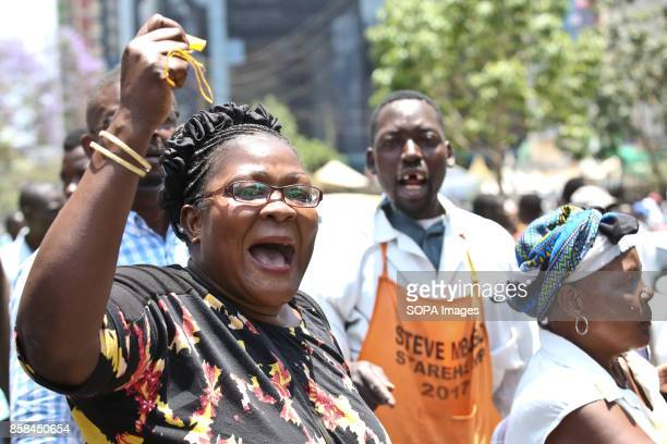 Opposition supporter shout as they protest over the electoral reforms before the 26th October repeat presidential election antriot police tear gassed...