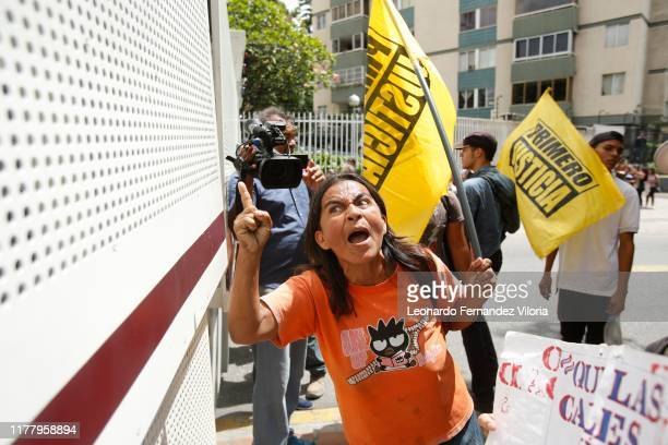 Opposition supporter shouts to National Guard members behind a barricade during a protest due to power, water and communication services faults in...