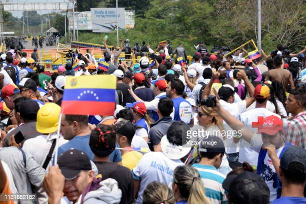 Opposition supporters attempt to pass through a blockage to admit humanitarian aid into Venezuela at the Francisco de Paula Santander bridge near the...