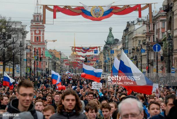 Opposition supporters attend an unauthorized antiPutin rally called by opposition leader Alexei Navalny on May 5 2018 in Saint Petersburg two days...