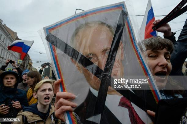 TOPSHOT Opposition supporters attend an unauthorized antiPutin rally called by opposition leader Alexei Navalny on May 5 2018 in Saint Petersburg two...