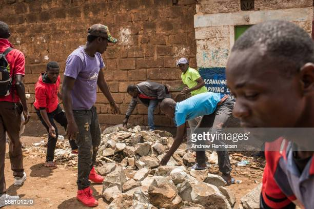 Opposition supporters block a road after Cabinet Secretary Fred Matiang'i visited a local school in the Kawangware slum on October 30 2017 in Nairobi...