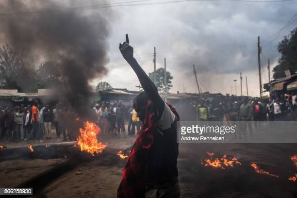 Opposition supporters burn tires in protest for presidential candidate Raila Odinga in the Kibera slum on October 25 2017 in Nairobi Kenya Tensions...
