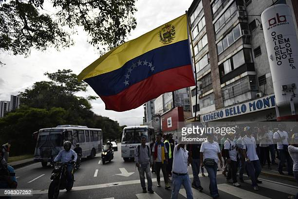 Opposition supporters carrying a flag march in Caracas Venezuela on Thursday Sept 1 2016 Venezuela's opposition is marching in Caracas to pressure...