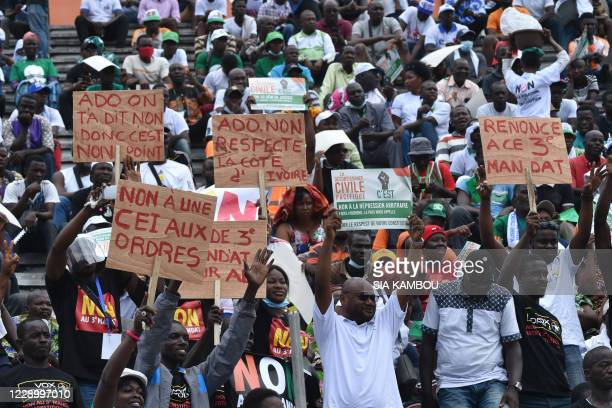 Opposition supporters demonstrate during a meeting against the candidacy for reelection of the incumbent president on October 10 2020 in Felix...