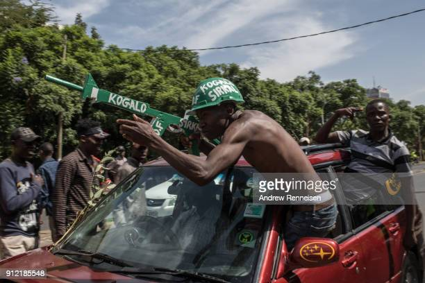 Opposition supporters demonstrate prior to a mock 'swearingin' ceremony of presidential candidate Raila Odinga on January 30 2018 at Uhuru Park in...