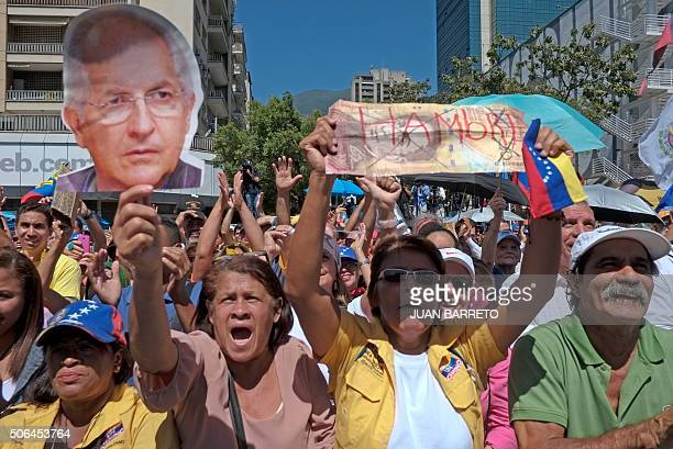 Opposition supporters hold a picture of jailed Caracas' Mayor Antonio Ledezma and a crossed sign reading 'Hunger' during a demonstration in Caracas...