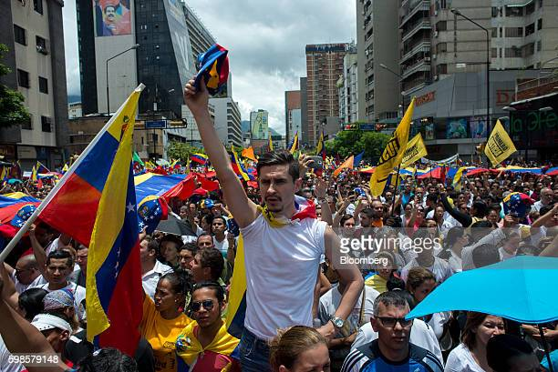 Opposition supporters hold Venezuelan flags and sing the national anthem during a protest in Caracas Venezuela on Thursday Sept 1 2016 Venezuelans...