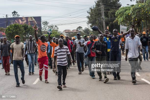 Opposition supporters march down Ngong Road on October 29 2017 in Nairobi Kenya Tensions remain high in Kenya after the controversial rerun election...