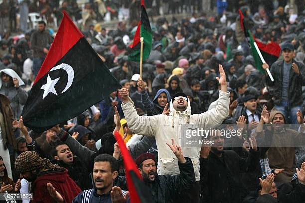 Opposition supporters pray in the rain March 4 2011 in Benghazi Libya Thousands of protesters gathered for Friday prayers and listened to a call to...