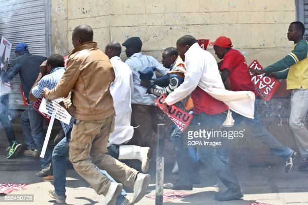 Opposition supporters scamper for safety as the antriot police tear gassed them on Nairobi streets Kenyan opposition coalition National Supper...