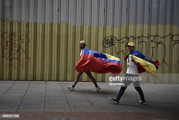 Opposition supporters walk to participate in a march in Caracas Venezuela on Thursday Sept 1 2016 Venezuela's opposition is marching in Caracas to...