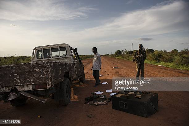 Opposition troops look through an abandoned SPLA government vehicle the day after heavy fighting between opposition and government troops in Bentiu...