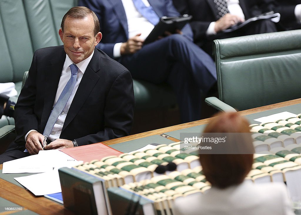 Oppostion leader Tony Abbott looks at Prime Minister Julia Gillard during House of Representatives question time at Parliament House on February 7, 2013 in Canberra, Australia. Parliament resumes for the first sitting of 2013 this week, just days after Prime Minister Gillard, announced a federal election date of September 14, 2013.