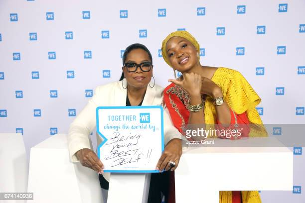 Oprah and motivational speaker Mpumi Nobiva pose for a photo at WE Day California to celebrate young people changing the world at The Forum on April...