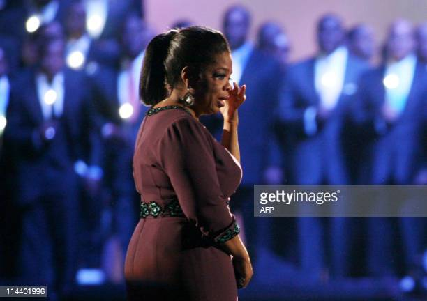 Oprah becomes emotional as Kristin Chenoweth performs surrounded by graduates of Moorehouse College on stage during the taping of the third to last...
