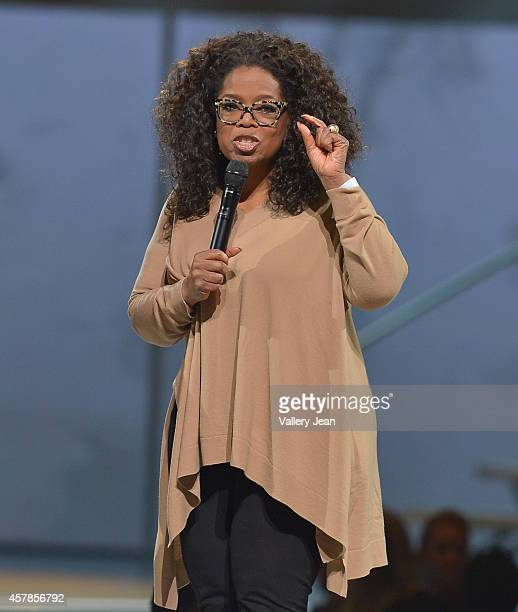 Oprah onstage at Oprahs The Life You Want Weekend at American Airlines Arena on October 25 2014 in Miami Florida