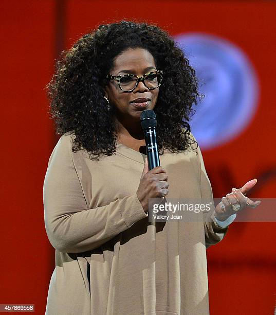 Oprah onstage at Oprah's The Life You Want Weekend at American Airlines Arena on October 25 2014 in Miami Florida