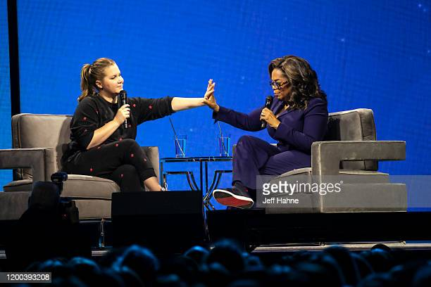 Oprah Winfrey and Amy Schumer speak during Oprah's 2020 Vision Your Life in Focus Tour presented by WW at Spectrum Center on January 18 2020 in...