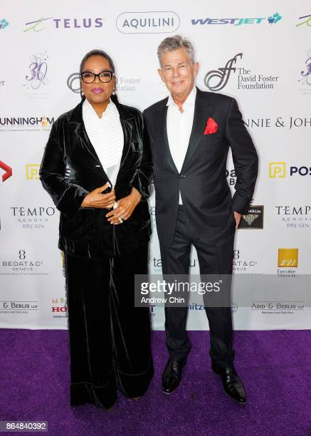 Oprah Winfrey and David Foster attend the David Foster Foundation Gala at Rogers Arena on October 21 2017 in Vancouver Canada