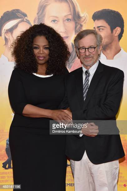 Oprah Winfrey and director Steven Spielberg attend the 'The HundredFoot Journey' New York premiere at Ziegfeld Theater on August 4 2014 in New York...