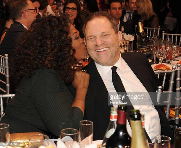 Oprah Winfrey and Harvey Weinstein attend the19th Annual Critics' Choice Movie Awards at Barker Hangar on January 16 2014 in Santa Monica California