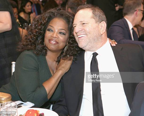 Oprah Winfrey and Harvey Weinsteinwith Champagne Nicolas Feuillatte at the 19th Annual Critics' Choice Movie Awards at Barker Hangar on January 16...