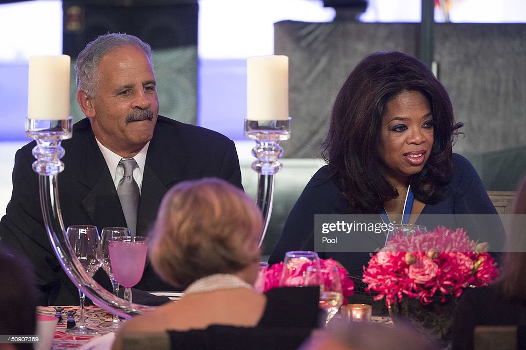 Oprah Winfrey and Stedman Graham attend a dinner in honor of the Medal of Freedom awardees at the Smithsonian National Museum of American History on November 20, 2013 in Washington, DC. The Presidential Medal of Freedom is the nation's highest civilian honor, presented to individuals who have made meritorious contributions to the security or national interests of the United States, to world peace, or to cultural or other significant public or private endeavors.