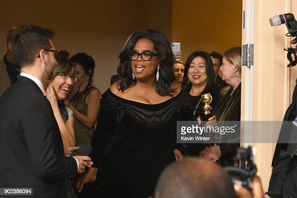 Oprah Winfrey arrives with the Cecil B DeMille Award in the press room during The 75th Annual Golden Globe Awards at The Beverly Hilton Hotel on...