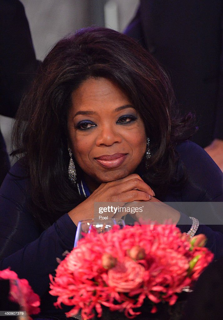 Oprah Winfrey attends a dinner in honor of the Medal of Freedom awardees at the Smithsonian National Museum of American History on November 20, 2013 in Washington, DC. The Presidential Medal of Freedom is the nation's highest civilian honor, presented to individuals who have made meritorious contributions to the security or national interests of the United States, to world peace, or to cultural or other significant public or private endeavors.