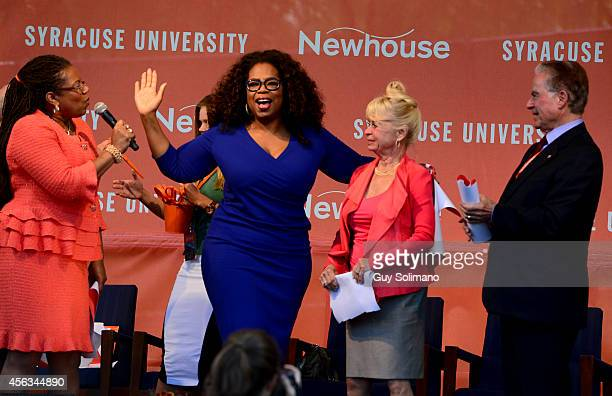 Oprah Winfrey center puts her arm around Kari Clark widow of Dick Clark during the Dick Clark Studios dedication ceremony at the S I Newhouse School...