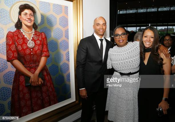Oprah Winfrey Dr Jungmiwha Bullock and artist Kadir Nelson with his painting of Henrietta Lacks attend the DC premiere of HBO Films' 'The Immortal...