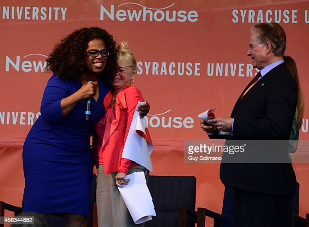 Oprah Winfrey embraces Kari Clark widow of Dick Clark during the Dick Clark Studios dedication ceremony at the S I Newhouse School of Public...