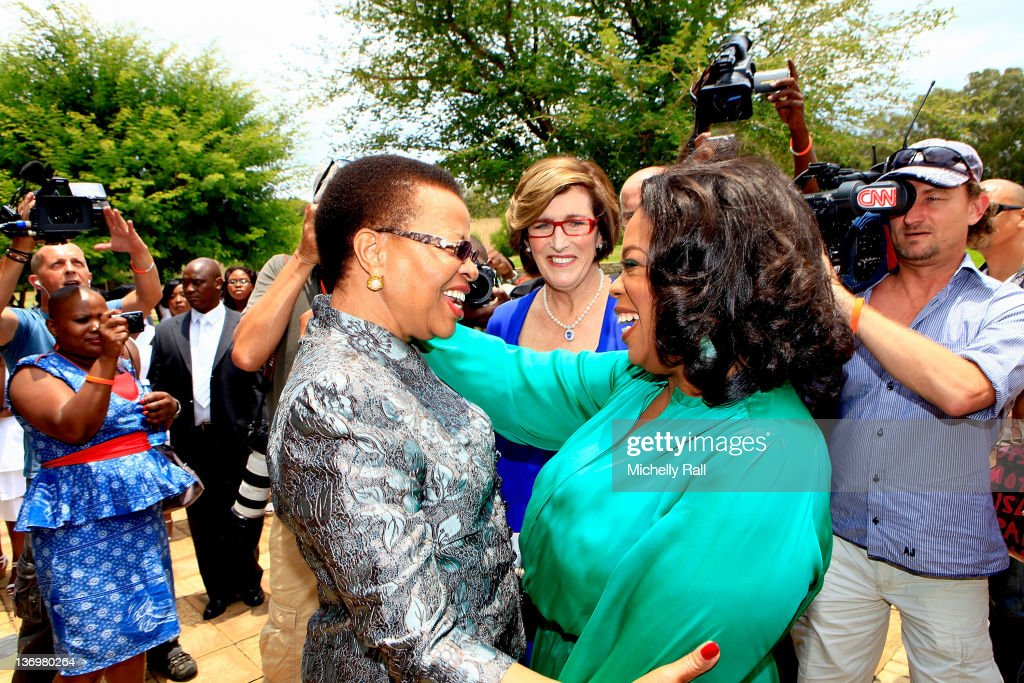 Oprah Winfrey greets Graca Machel (L), the wife of former South African president Nelson Mandela, on her arrival at the inaugural graduation of the class of 2011 at Oprah Winfrey Leadership Academy for Girls on January 14, 2012 in Henley on Klip, South Africa.