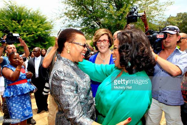 Oprah Winfrey greets Graca Machel the wife of former South African president Nelson Mandela on her arrival at the inaugural graduation of the class...
