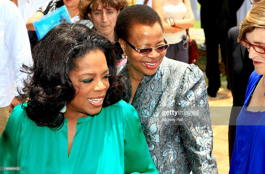 Oprah Winfrey greets Graca Machel (C), the wife of former South African president Nelson Mandela, and Principal of the OWLAG Anne Van Zyl on her arrival at the inaugural graduation of the class of 2011 at Oprah Winfrey Leadership Academy for Girls on January 14, 2012 in Henley on Klip, South Africa.
