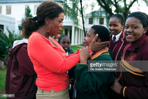 Oprah Winfrey holds one of the girls that she interviewed for her school for unprivileged girls on August 10 2006 in Johannesburg South Africa Oprah...