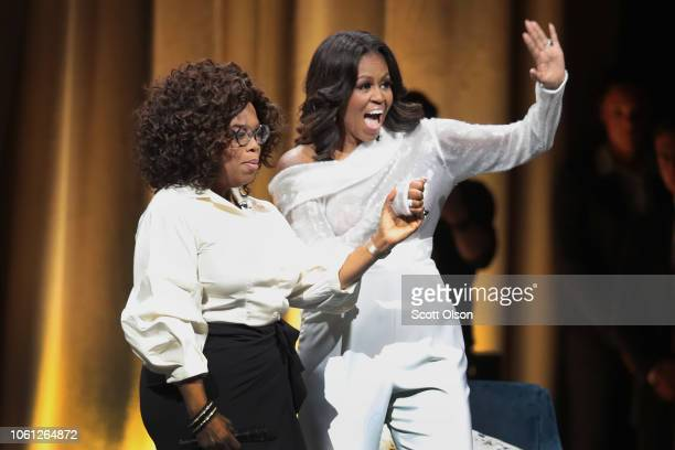 Oprah Winfrey introduces former first lady Michelle Obama as she kicks off her 'Becoming' arena book tour on November 13 2018 in Chicago Illinois In...
