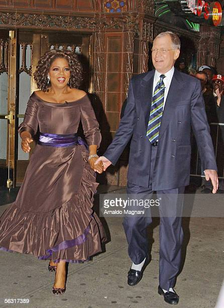 """Oprah Winfrey is escorted by David Letterman after the taping of """"The Late Show with David Letterman"""" to the Broadway opening of """"The Color Purple,""""..."""