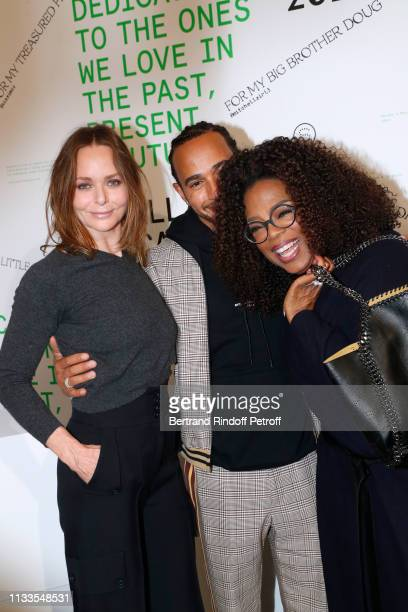 Oprah Winfrey Lewis Hamilton and Oprah Winfrey pose after the Stella McCartney show as part of the Paris Fashion Week Womenswear Fall/Winter...
