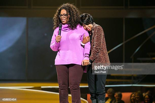 Oprah Winfrey poses with a fan at The Life You Want event on November 8 2014 in Seattle Washington