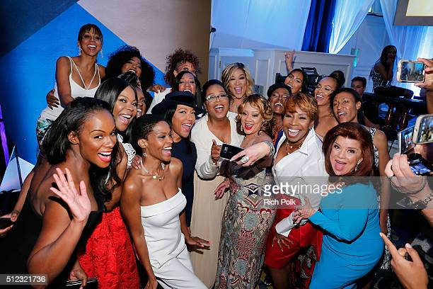 Oprah Winfrey poses with guests during the 2016 ESSENCE Black Women In Hollywood awards luncheon at the Beverly Wilshire Four Seasons Hotel on...