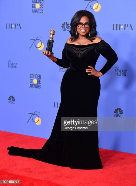 Oprah Winfrey poses with the Cecil B DeMille Award in the press room during The 75th Annual Golden Globe Awards at The Beverly Hilton Hotel on...