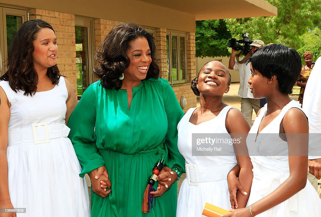 Oprah Winfrey poses with the Graduates at the inaugural graduation of the class of 2011 at Oprah Winfrey Leadership Academy for Girls on January 14, 2012 in Henley on Klip, South Africa.